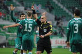 WROCLAW, POLAND - November 25: Referee shows yellow card againts Jagielonia, Slask Wroclaw vs Jagielonia Bialystok on November 25, 2012 in Wroclaw, Poland. — Stock Photo