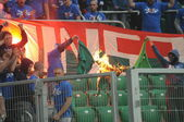 WROCLAW, POLAND - May 06: ultra supporters burn flares during match, Slask Wroclaw vs Lech Poznan on May 06, 2013 in Wroclaw, Poland. — Stock Photo