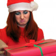 Christmas Gift - woman opening gift disappointed and unhappy — Stock Photo
