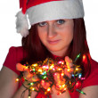 Woman with christmas garland lights — Stock Photo