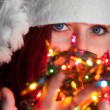 Woman with christmas garland lights — Stock Photo #31884837