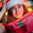 Happy young woman opening gift box — Stock Photo