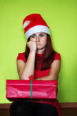 Bored and disappointed woman holding present — Stok fotoğraf