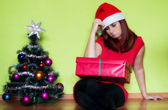 Sad young woman alone in Christmas time — Stock Photo