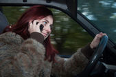 Woman talking on the phone while driving — Stock Photo