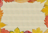Frame composed of colorful autumn leaves with papper — Stock Photo