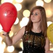 Young Woman holding a balloons on new year — Stock Photo