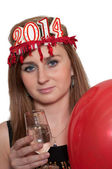 Smiling woman holding new year's champagne and balloons — Stock Photo