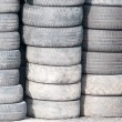 Background with old tires on each other — Stock Photo #35720089