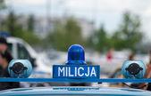 Polish Milicja (Old Police) sign on a old car — Stock Photo