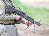 Soldier with heavy machine gun — Stock Photo