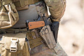 Soldiers in US Army Special Forces uniform, close up on pistol — Stock Photo
