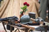 World war 2 equipment - rifle, hand grenade uniform and rose — Stock Photo