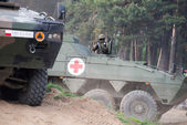 Wroclaw, Poland - May 10. 2014:  AMV XC-360P Rosomak armored vehicle with armored medical support on Military show on May 10, 2014 in Worclaw, Poland — Stock Photo