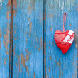 Stock Photo: Heart on woody background