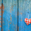 Stock Photo: Small heart on woody background
