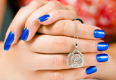 Jewelry in woman hands — Stock Photo