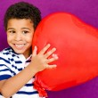 AMerican african boy with heart — Stock Photo