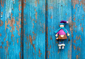 Doll on woody backgroud — Stock Photo