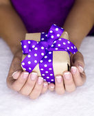 Present in a women hand — Stock Photo
