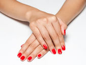 Hands with red manicure — Stock Photo