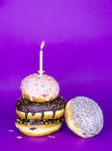 Donuts tower with candle — Stock Photo