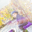 Stock Photo: Child with autumn flowers