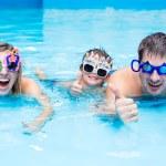 Family in aqua centre — Stock Photo