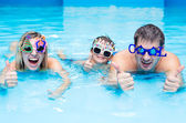 Family in aqua centre — Stock Photo