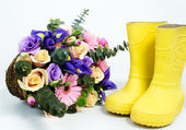 Flowers with boots — Stock Photo