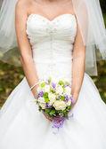 Bride in a white dress — Stock Photo