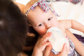 Mother feeding her little baby — Stock Photo