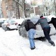Car stuck in the snow — Stock Photo #22913384