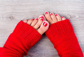 Female legs with a color pedicure — Stock Photo