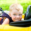 Boy won his yellow car — Stock Photo