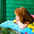 Red hair girl in the park — Stock Photo