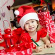 Cute child in santa hat — Stock Photo