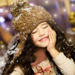 Cute little girl eats chocolate and dreaming about Christmas — Stock Photo #35054341