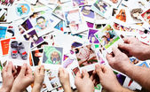 Set of images in family hands — Stock fotografie