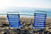 Sun beds on the sea beach — Stock Photo