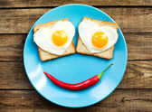Funny fried eggs for the brakfast — Stock Photo