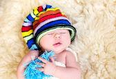 Sweet cute baby n colorful cap — Stock Photo