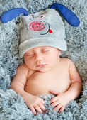 Infant sleeping in a soft blanket — Stock Photo