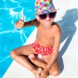 Cute boy on vacation next to the waterpool — Stock Photo #50494923