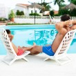 Cute boy on vacation next to the waterpool — Stock Photo #50494949