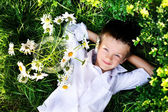 The boy relaxing in the park — Stock Photo