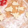 Making biscuits for christmas decorations, kitchen in a backgrou — Φωτογραφία Αρχείου