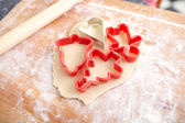 Making biscuits for christmas decorations, kitchen in a backgrou — Stock Photo