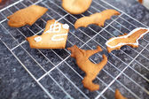 Baked biscuits for halloween decoration, kitchen in a background — Stock Photo