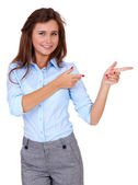 Young attractive businesswoman point to her side, isolated — Stock Photo